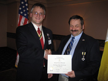 President Rich Fullam congratulates and welcomes George Malinoski to the Chapter (Photo Courtesy of Duane Booth)