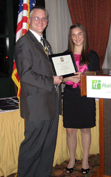 Rich receives certificate from Lexi - Photo: Duane Booth