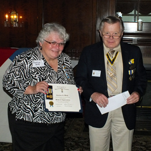 Chapter President Thomas L. Dunne presents Tawasentha Chapter, NSDAR member Caroline G. Wirth with the SAR Daughters of Liberty Award at their Annual Meeting which was held at the Albany Country Club in Voorheesville, NY.  Mrs. Wirth has enrolled sons Garrett A. and Carl D. Wirth  and grandsons Carl J. Wirth and Christopher A. Lavigne in our chapter.  Past Chapter President & current State President Duane Booth and Historian Karl L. Danneil and wife Eleanor Morris were in attendance.  Duane gave a presentation about the SAR to the DAR chapter members.  Photo courtesy of Karl Danneil