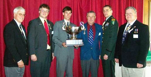 Click for larger image.  L-R Duane Booth, Rich Fullam, Jonathan Goebel with the Addams Cup, George Ballard, Peter Goebel & Bill Woodworth. Photo courtesy of Duane Booth.