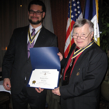 Immediate Past President Primitivo Africa receives certificate and pin from Chapter President Thomas Dunne