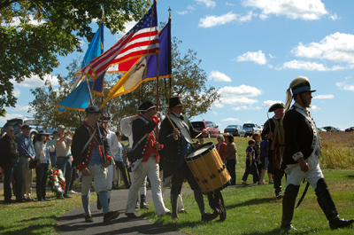 Re-enactors present colors under the command of General Gates - Photo: Joyce Armstrong