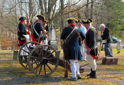 Re-enactors ready their two pound artillery piece for firing - Photo by George Ballard